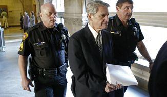 FILE - In this Oct. 23, 2014 file photo, Dr. Robert Ferrante, center, is escorted by Allegheny County Sheriffs deputies to court during jury selection for his trial on homicide charges in the 2013 killing of his neurologist wife, Dr. Autumn Klein, with cyanide in Pittsburgh. Ferrante's attorney filed an appeal on Wednesday, July 12, 2017 in Superior Court on Ferrante's 2014 first-degree murder conviction in the case. The attorney argues there wasn't enough evidence to convict Ferrante, and contests the reliability of lab results that concluded Klein was poisoned. (AP Photo/Keith Srakocic, FILE)