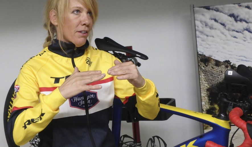 In this July 6, 2017 photo, ultracylist Thursday Gervais explains how her bike components  work during a talk in Peoria Heights, Ill., about her upcoming ride across Siberia in the 5,700 mile Red Bull Trans-Siberian Extreme race. Gervais is among 12 people competing in the ultra stage bicycle race. In the two years it has been run, only three solo riders have completed it. All have been men. Gervais is looking to change that. (Lenore Sobota/The Pantagraph via AP)