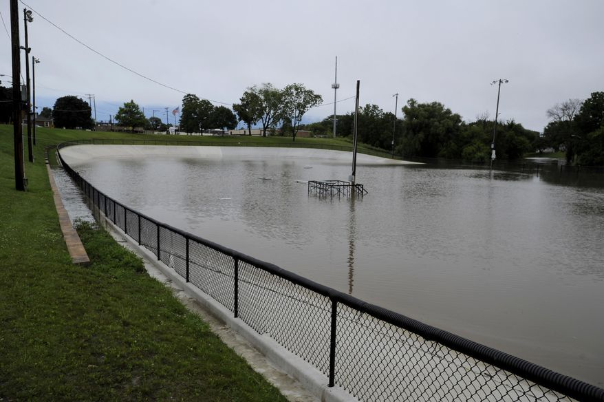 The newly renovated Washington Park Velodrome filled with water from nearby Pike Creek after a heavy rain storm Wednesday morning, July 12, 2017. Heavy thunderstorms are causing travel difficulties around southern Wisconsin because of flooding. Numerous municipalities are dealing with impassable streets. (Sean Krajacic/The Kenosha News via AP)