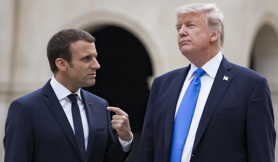 French President Emmanuel Macron, left, talks to U.S President Donald Trump while leaving Les Invalides museum in Paris, Thursday, July 13 2017 as part of Trump's visit to France for Bastille Day celebrations in Paris. (Ian Langsdon, Pool via AP)