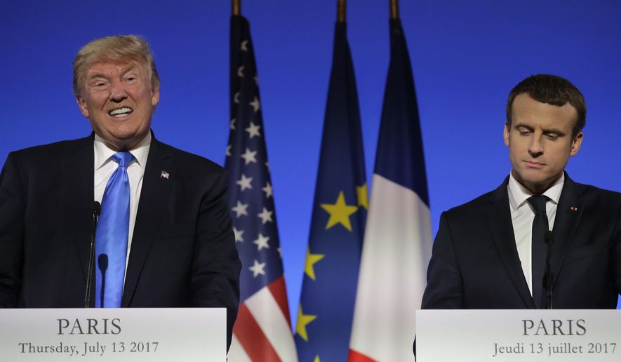 "U.S President Donald Trump, left, speaks during a press conference with French President Emmanuel Macron at the Elysee Palace in Paris, Thursday, July 13, 2017. President Donald Trump is saluting the United States' ""unbreakable"" bond with France. (AP Photo/Markus Schreiber)"