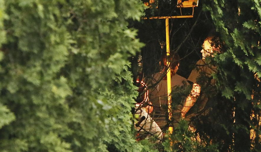 Authorities search the backyard at the home of Lillian Webb, wife of fugitive Donald Eugene Webb, in Dartmouth, Mass., Thursday, July 13, 2017.  Authorities began a dig at the home Thursday hoping to find evidence in their decadeslong quest to find the man wanted in the slaying of a Pennsylvania police chief in 1980. (Mike Valeri/Standard Times via AP)