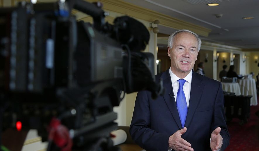 Arkansas Republican Gov. Asa Hutchinson discusses the health care bill under consideration by the U.S. Senate during a television news interview on the first day of the National Governor's Association meeting Thursday, July 13, 2017, in Providence, R.I. (AP Photo/Stephan Savoia)