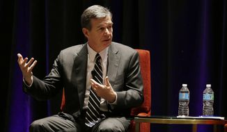 "North Carolina Democratic Gov. Roy Cooper participates in a panel discussion during a session called ""Curbing The Opioid Epidemic"" at the first day of the National Governor's Association meeting Thursday, July 13, 2017, in Providence, R.I. (AP Photo/Stephan Savoia)"