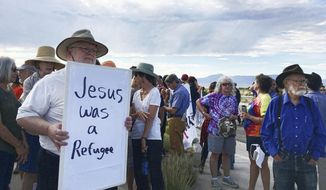 Demonstrators rally in support of Iraqi refugee Kadhim Al-bumohammed outside of Immigration and Customs Enforcement offices in Albuquerque on Thursday, July 13, 2017. Al-bumohammed opted to skip his scheduled federal immigration hearing Thursday where he was expected to be detained, and instead said he is seeking sanctuary at an Albuquerque church. (AP Photo/Russell Contreras)