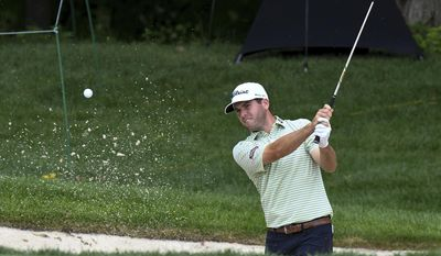 Ben Martin blasts out of the sand at the 9th green during the John Deere Classic golf tournament Wednesday, July 12, 2017, in Silvis, Ill. (Todd Mizener/QCOnline.com via AP)