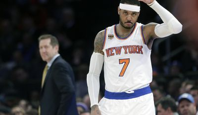 FILE - In this April 4, 2017, file photo, New York Knicks' Carmelo Anthony (7) checks in as coach Jeff Hornacek, left, watches during the first half of an NBA basketball game against the Chicago Bulls, in New York. The New York Knicks and Houston Rockets continue talking about a trade for Carmelo Anthony, though a person with knowledge of the details says no deal is imminent.  Anthony has told the Knicks he would accept a move to the Rockets but the teams are still trying to find a trade that works for both sides, the person told The Associated Press on Thursday, July 13, 2017. (AP Photo/Frank Franklin II, File)