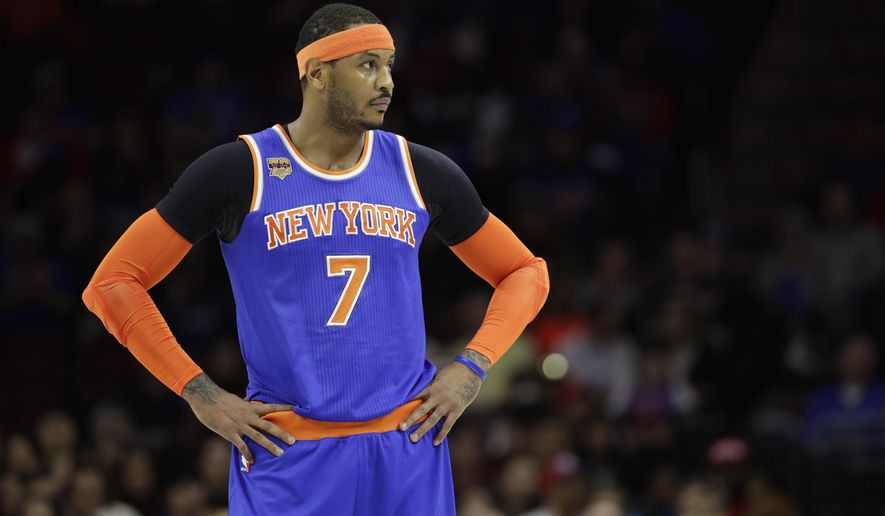 FILE - In this March 3, 2017, file photo, New York Knicks' Carmelo Anthony is shown during an NBA basketball game against the Philadelphia 76ers, in Philadelphia. The New York Knicks and Houston Rockets continue talking about a trade for Carmelo Anthony, though a person with knowledge of the details says no deal is imminent.  Anthony has told the Knicks he would accept a move to the Rockets but the teams are still trying to find a trade that works for both sides, the person told The Associated Press on Thursday, July 13, 2017. (AP Photo/Matt Slocum, File)