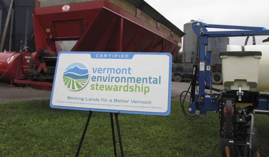A sign for a new Vermont program is displayed on a farm in Williston, Vt., Thursday, July 13, 2017. The voluntary pilot program certifies the state's most environmentally friendly farms through soil testing and other monitoring. (AP Photo/Lisa Rathke)