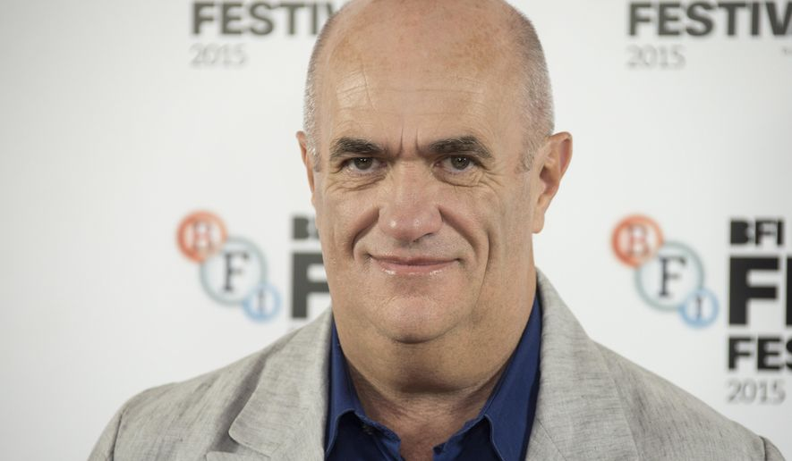 FILE - In this Oct. 12, 2015 file photo, author Colm Toibin poses for photographers during the photo call for Brooklyn, as part of the London Film Festival, at a central London hotel. Irish novelist, journalist and essayist Toibin is this year's winner of a lifetime achievement award that celebrates the power of literature to foster peace, social justice and global understanding, organizers announced Thursday, July 13, 2017. Toibin will receive this year's Richard C. Holbrooke Distinguished Achievement Award. (Photo by Joel Ryan/Invision/AP, File)