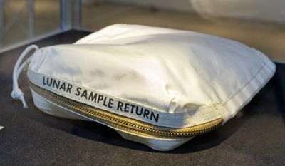 The Apollo 11 Contingency Lunar Sample Return Bag used by astronaut Neil Armstrong, to be offered at auction, is displayed at Sotheby's, in New York, Thursday, July 13, 2017. The lunar dust plus some tiny rocks that Armstrong also collected are zipped up in a small bag and are worth an estimated $2 million to $4 million. (AP Photo/Richard Drew)