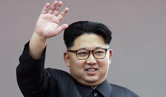 In this May 10, 2016, file photo, North Korean leader Kim Jong-un waves at parade participants at the Kim Il-sung Square in Pyongyang, North Korea. (AP Photo/Wong Maye-E, File)