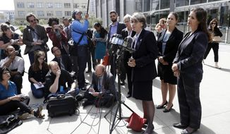 Oakland city officials including Mayor Libby Schaaf, right, city administrator Sabrina Landreth, second from right, and police chief Anne Kirkpatrick, at podium, field questions after a federal court hearing, Monday, July 10, 2017, in San Francisco. Civil rights lawyers say a federal judge should consider holding Oakland, California, city and police officials in contempt of court for mishandling an internal affairs investigation of several officers alleged to have sexually exploited an underage prostitute. (AP Photo/Marcio Jose Sanchez)