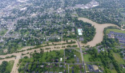 The Blanchard River flooding seen in an aerial photo looking north from the Hancock County fairgrounds in Findlay, Ohio, Thursday, July 13, 2017. Riverside Park including the blue pools are just right of center. Major flooding is being predicted over the coming days in northwestern Ohio where residents in Findlay are piling up sandbags. (Matthias Leguire/The Courier via AP)