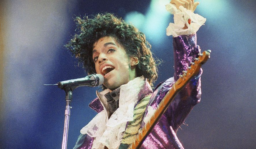 FILE - In this Feb. 18, 1985 file photo, Prince performs at the Forum in Inglewood, Calif. A Minnesota judge has ruled Thursday, July 13, 2017, that Universal Music Group should be released from a music rights deal with Prince's estate. Universal struck a deal with the estate in January, but the estate later sought to cancel the deal after Warner Bros. Records claimed it conflicted with a contract it signed with Prince in 2014. (AP Photo/Liu Heung Shing, File)