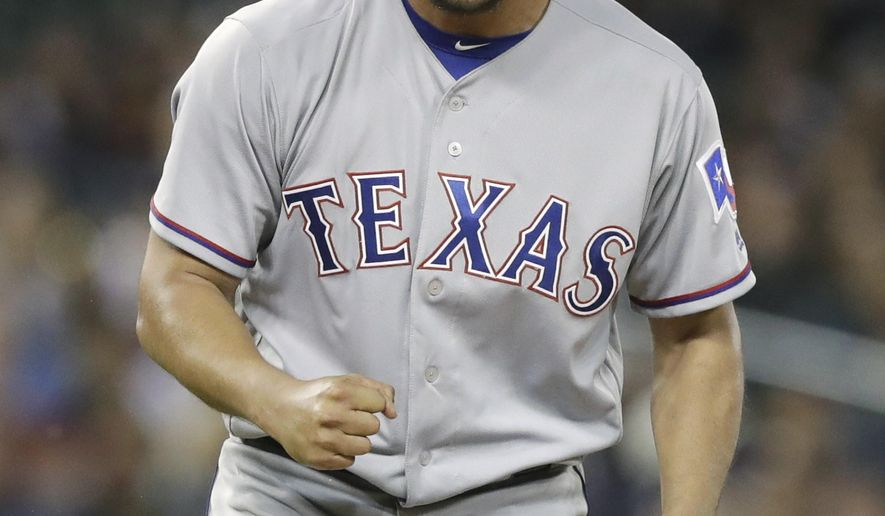 FILE - In this May 21, 2017, file photo, Texas Rangers starting pitcher Yu Darvish reacts after the third out during the fifth inning of a baseball game against the Detroit Tigers, in Detroit. Yu Darvish could be going into his final stretch with the Rangers. The right-hander from Japan can become a free agent after this season. (AP Photo/Carlos Osorio, File)