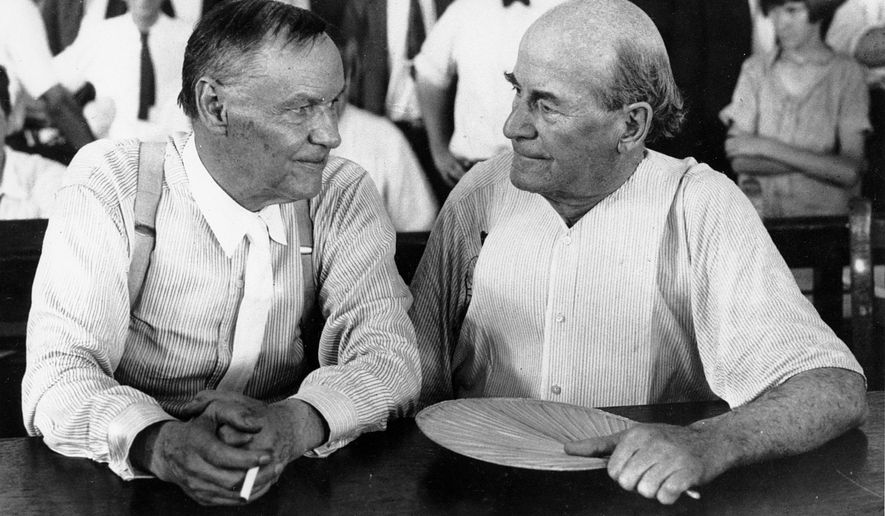 FILE - In this July 1925 file photo, Clarence Darrow, left, and William Jennings Bryan speak with each other during the monkey trial in Dayton, Tenn. On Friday, July 13, 2017, at the Rhea County Courthouse in Dayton, the public will behold a 10-foot statue of the rumpled skeptic Darrow, who argued for evolution in the 1925 trial. It will stand at a respectful distance on the opposite side of the courthouse from an equally huge statue of Bryan, the eloquent Christian defender of the biblical account of creation, which was installed in 2005. (AP Photo, File)
