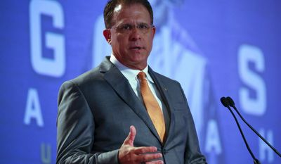 Auburn NCAA college football coach Gus Malzahn speaks during the Southeastern Conference's annual media gathering, Thursday, July 13, 2017, in Hoover, Ala. (AP Photo/Butch Dill)