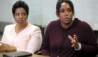 Latasha Nelson, right, speaks at a news conference with attorney Kim T. Cole, left, on Thursday, July 13, 2017, at the Next Generation Action Network in Dallas. Nelson says police in the Dallas suburb of Arlington offered to drop charges against her two teenage sons in exchange for a cellphone video she shot that allegedly shows an officer needlessly pushing her older son to the ground and arresting him. (AP Photo/Jaime Dunaway)