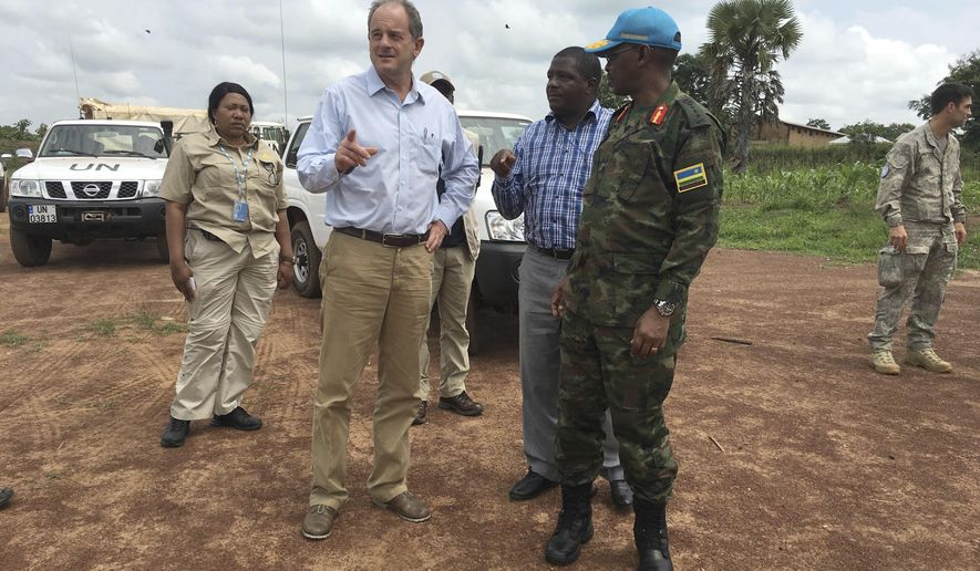 "David Shearer, second left, the United Nations peacekeeping mission chief in South Sudan, visits the troubled region of Yei, South Sudan. Thursday, July 13. 2017. Shearer says he's considering putting a permanent U.N. presence in the town, but only if the government grants unrestricted access. The United Nations says it is considering putting a peacekeeping base in South Sudan's troubled Yei region, the first such expansion since civil war began in 2013. The peacekeeping mission's chief says Yei has ""gone through a nightmare."" Since fighting spread to the city a year ago, 70 percent of the population has fled. (AP Photo/Sam Mednick)"