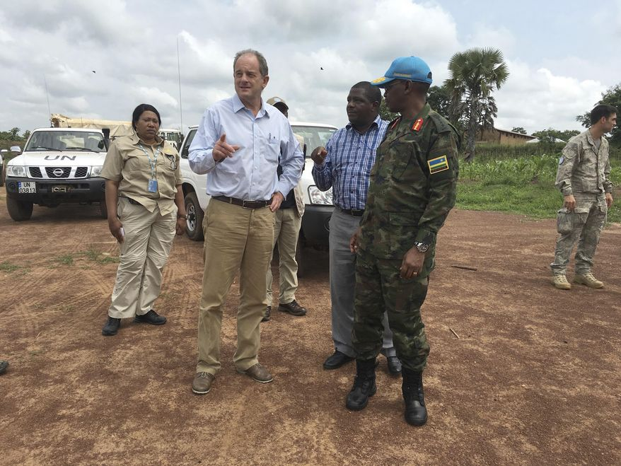 """David Shearer, second left, the United Nations peacekeeping mission chief in South Sudan, visits the troubled region of Yei, South Sudan. Thursday, July 13. 2017. Shearer says he's considering putting a permanent U.N. presence in the town, but only if the government grants unrestricted access. The United Nations says it is considering putting a peacekeeping base in South Sudan's troubled Yei region, the first such expansion since civil war began in 2013. The peacekeeping mission's chief says Yei has """"gone through a nightmare."""" Since fighting spread to the city a year ago, 70 percent of the population has fled. (AP Photo/Sam Mednick)"""
