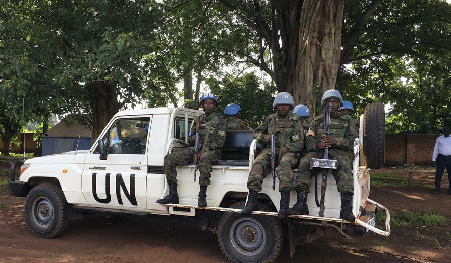 "United Nations Peacekeepers drive in a truck in Yei, South Sudan, Thursday, July 13, 2017. The United Nations says it is considering putting a peacekeeping base in South Sudan's troubled Yei region, the first such expansion since civil war began in 2013. The peacekeeping mission's chief says Yei has ""gone through a nightmare."" Since fighting spread to the city a year ago, 70 percent of the population has fled. (AP Photo/Sam Mednick)"