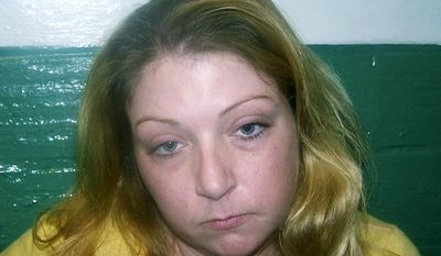 """FILE - This undated file booking photo released by the Salisbury Police Department shows Leslie Aberle, arrested on a fugitive from justice charge in Salisbury, Mass. Aberle is tentatively scheduled to appear in federal court Thursday, July 13, 2017, to plead guilty in a proposed plea agreement to conspiracy to distribute and to possess with intent to distribute heroin and fentanyl in the case of Evangelique """"Eve"""" Tarmey, who was found dead at a motel in Rochester, N.H., in October 2015. (Salisbury Police Department via AP, File)"""