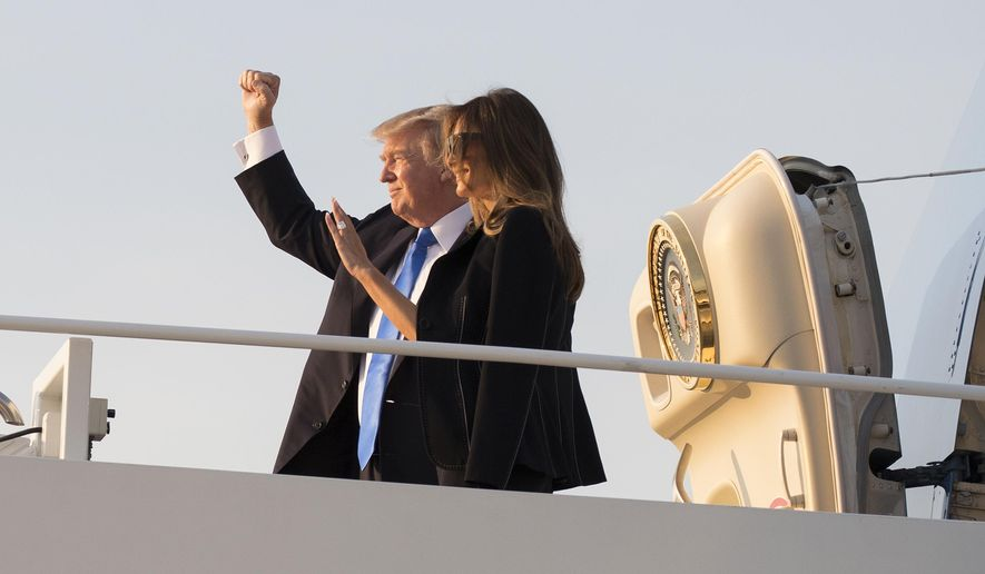 President Donald Trump and first lady Melania Trump board Air Force One, Wednesday, July 12, 2017, in Andrews Air Force Base, Md., en route to Paris. (AP Photo/Carolyn Kaster)