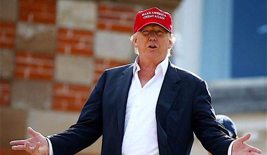 """President Trump wear his signature """"Make American Great Again"""" cap. The idea has now been applied to the Nation's economy.  ((Scott Heppell/AP Photo)"""
