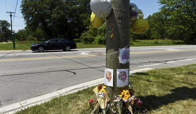 In this Thursday, July 6, 2017 photo, a memorial for Whittaker, a wild turkey who lived near the intersection of Whittaker and Textile roads sits in Ypsilanti Township, Mich. The Humane Society of Huron Valley said the turkey known as Whittaker was accidentally hit on July 3 and was euthanized due to severe injuries. (Melanie Maxwell/The Ann Arbor News via AP)