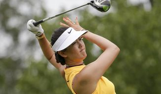 Michelle Wie watches her tee shot on the eighth hole during the first round of the U.S. Women's Open Golf tournament Thursday, July 13, 2017, in Bedminster, N.J. (AP Photo/Seth Wenig)