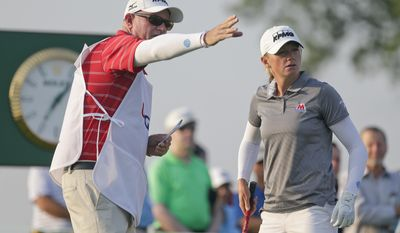 Stacy Lewis talks with her caddie before teeing off on the 10th hole during the first round of the U.S. Women's Open Golf tournament Thursday, July 13, 2017, in Bedminster, N.J. (AP Photo/Seth Wenig)