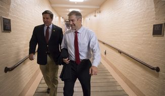 Rep. Ron DeSantis, R-Fla., left, and Rep. Jim Jordan, R-Ohio, walk to a meeting with fellow Republicans on Capitol Hill in Washington, Friday, July 14, 2017, to reconcile the GOP's long-overdue budget blueprint, even as divisions between moderates and conservatives over cutting programs like food stamps threaten passage of the measure. (AP Photo/J. Scott Applewhite) ** FILE **