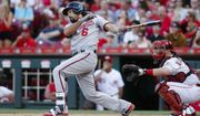 Washington Nationals' Anthony Rendon watches an RBI single off Cincinnati Reds starting pitcher Tim Adleman during the first inning of a baseball game, Friday, July 14, 2017, in Cincinnati. (AP Photo/John Minchillo)