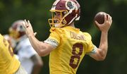"FILE - In this June 14, 2017, file photo, Washington Redskins quarterback Kirk Cousins (8) looks to pass during NFL football practice, in Ashburn, Va. With the deadline for a long-term deal with Kirk Cousins looming, Eric Schaffer, the team's ""chief negotiator""is arguably the most important person in the Redskins' front office. (AP Photo/Nick Wass, File)"