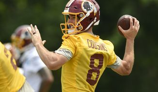 """FILE - In this June 14, 2017, file photo, Washington Redskins quarterback Kirk Cousins (8) looks to pass during NFL football practice, in Ashburn, Va. With the deadline for a long-term deal with Kirk Cousins looming, Eric Schaffer, the team's """"chief negotiator""""is arguably the most important person in the Redskins' front office. (AP Photo/Nick Wass, File)"""