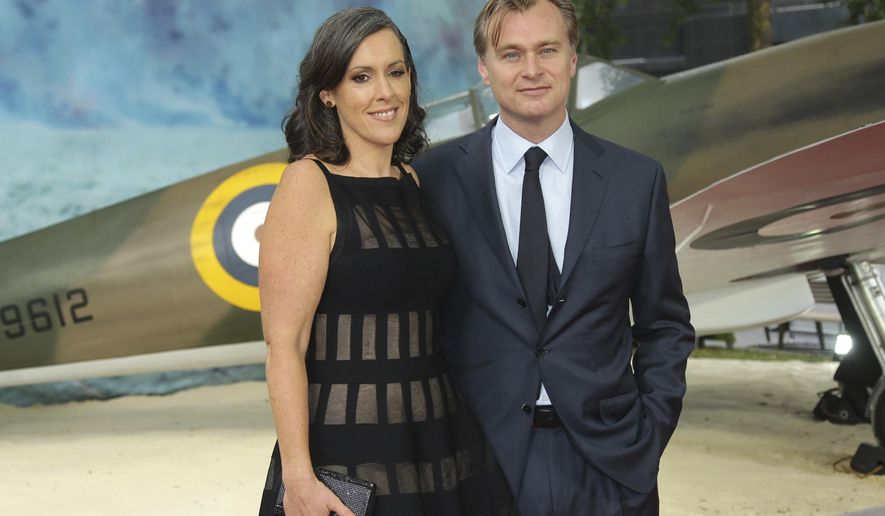 Director Christopher Nolan, right, and Emma Thomas pose for photographers upon arrival at the World premiere of the film 'Dunkirk' in London, Thursday, July 13th, 2017. (Photo by Joel Ryan/Invision/AP)