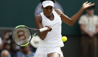 Venus Williams of the United States returns to Britain's Johanna Konta during their Women's Singles semifinal match on day nine at the Wimbledon Tennis Championships in London Thursday, July 13, 2017. (AP Photo/Kirsty Wigglesworth)