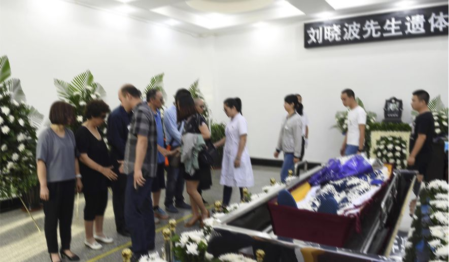 In this photo provided by the Shenyang Municipal Information Office, people attend the of jailed Nobel Peace Prize winner and Chinese dissident Liu Xiaobo during his funeral at a funeral parlor in Shenyang in northeastern China's Liaoning Province, Saturday, July 15, 2017. China says the body of Liu Xiaobo, who died this week after a battle with liver cancer, has been cremated. The government of the city of Shenyang in northeastern China, where Liu was treated, said in a briefing that the cremation took place Saturday morning in a ceremony attended by family and friends.  (Shenyang Municipal Information Office via AP)