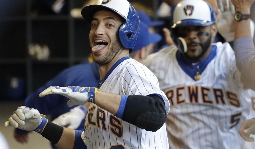 CORRECTS TO GRAND SLAM, INSTEAD OF THREE-RUN HOME RUN - Milwaukee Brewers' Ryan Braun celebrates his grand slam during the second inning of a baseball game against the Philadelphia Phillies on Friday, July 14, 2017, in Milwaukee. (AP Photo/Morry Gash)