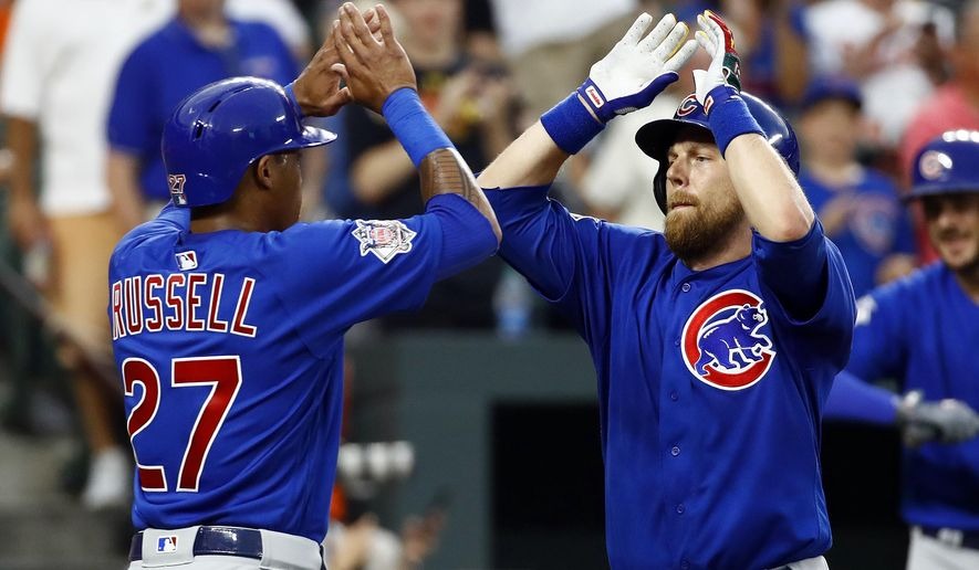Chicago Cubs' Ben Zobrist, right, high-fives teammate Addison Russell after batting him in on a two-run home run in the second inning of an interleague baseball game against the Baltimore Orioles in Baltimore, Friday, July 14, 2017. (AP Photo/Patrick Semansky)