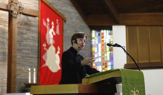 ADVANCED FOR RELEASE SATURDAY, JULY 15, 2017 Rev. Elizabeth Goudy delivers a sermon from the pulpit at the Metropolitan Community Church of the Lehigh Valley in Bethlehem, Pa., on June 25, 2017. (Erin Gallagher/The Express-Times via AP)