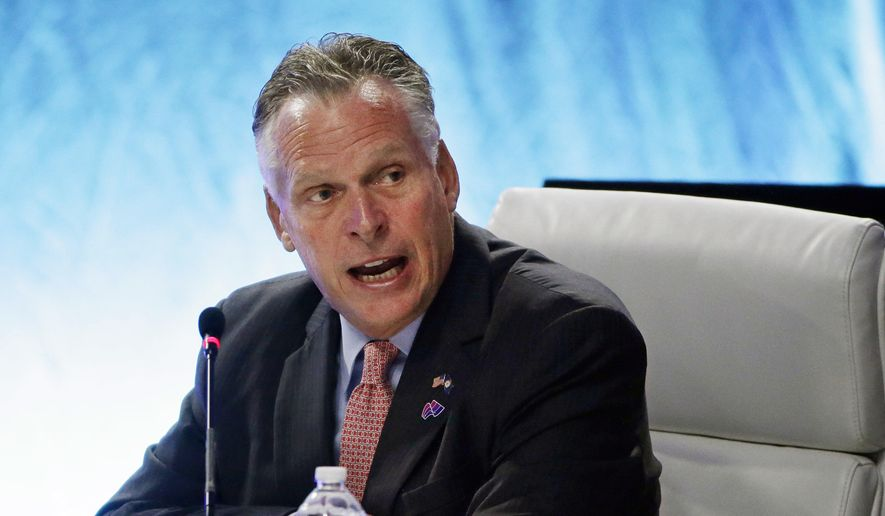 """Virginia Democratic Gov. Terry McAuliffe opens a """"Meet the Threat: States Confront the Cyber Challenge"""" plenary session"""" at the second day of the National Governors Association meeting Friday, July 14, 2017, in Providence, R.I. (AP Photo/Stephan Savoia)"""
