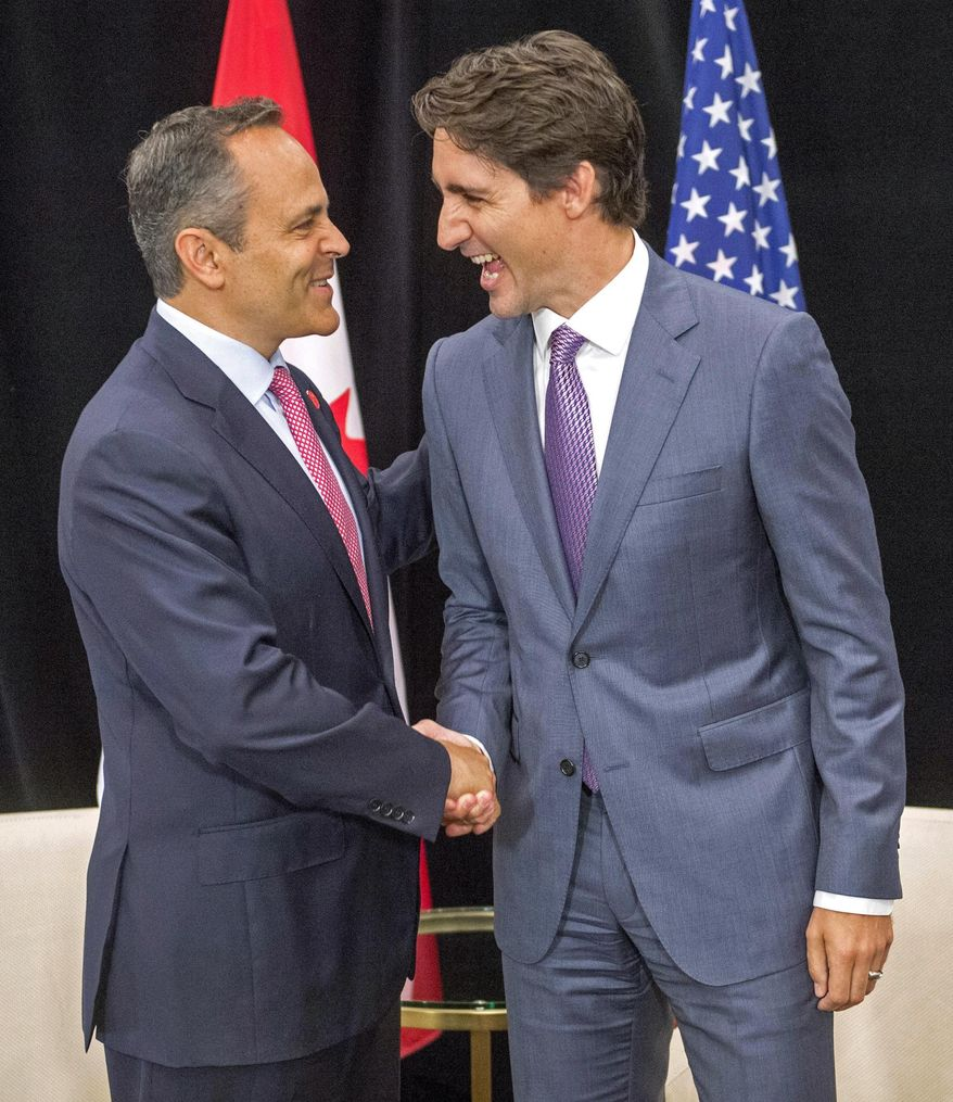 """Canada's Prime Minister Justin Trudeau, right, meets with Kentucky Governor Matt Bevin during a special session called """"Collaborating to Create Tomorrow's Global Economy"""" at the second day of the National Governors Association meeting Friday, July 14, 2017, in Providence, R.I. (Ryan Remiorz/The Canadian Press via AP)"""