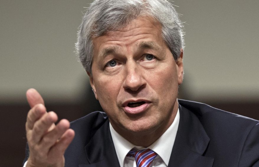 In this June 13, 2012, file photo, JPMorgan Chase CEO Jamie Dimon testifies before the Senate Banking Committee on Capitol Hill in Washington. During calls with reporters and Wall Street analysts on Friday, July 14, 2017, Dimon vented his irritation with politicians and the news media, arguing that the nation is spending too much time bickering instead of solving real issues. (AP Photo/J. Scott Applewhite, File)
