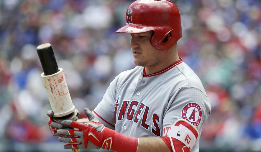 FILE - In this April 30, 2017, file photo, Los Angeles Angels' Mike Trout waits on deck for his at-bat against the Texas Rangers during a baseball game in Arlington, Texas. The two-time AL MVP is set to return to the Angels' lineup Friday after missing 39 games because of a torn ligament in his left thumb. Los Angeles opens the unofficial second half against Tampa Bay, which took three of four from Boston before the All-Star break to get within 3 1/2 games of the AL East lead. (AP Photo/Tony Gutierrez, File)