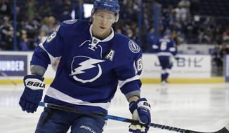 FILE - In this Thursday, Feb. 2, 2017 file photo, Tampa Bay Lightning left wing Ondrej Palat (18), of the Czech Republic, warms up before an NHL hockey game against the Ottawa Senators in Tampa, Fla. A person with direct knowledge of the move says the Tampa Bay Lightning have agreed to terms with left winger Ondrej Palat on a $26.5 million, five-year deal. he person spoke to The Associated Press on condition of anonymity Friday, July 14, 2017 because it had not been announced. (AP Photo/Chris O'Meara)