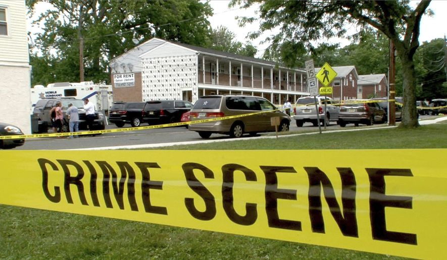 """Crime scene tape surrounds the Hancock Arms Apartment complex where the body of 11-year-old Abbiegail """"Abby"""" Smith was found in the morning behind the complex Thursday, July 13, 2017, in Keansburg, N.J. (Thomas P. Costello via AP)/The Asbury Park Press via AP) ** FILE **"""