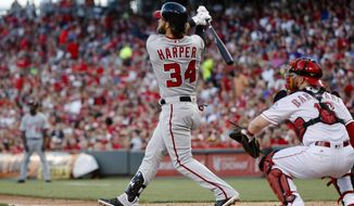 Washington Nationals' Bryce Harper watches his solo home run off Cincinnati Reds starting pitcher Tim Adleman during the fifth inning of a baseball game, Friday, July 14, 2017, in Cincinnati. (AP Photo/John Minchillo)