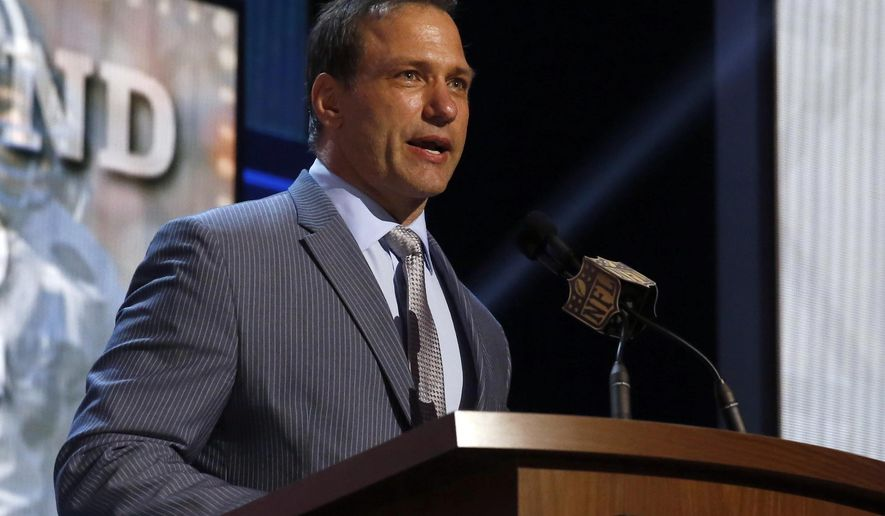 FILE - In this May 1, 2015, file photo, Chris Spielman speaks at the 2015 NFL Football Draft, in Chicago. One of Ohio State's most famous football stars sued the university Friday, July 14, 2017, over a marketing program he says used athletes' images without permission and robbed them of compensation. Linebacker Chris Spielman filed the antitrust lawsuit in federal court in Columbus on behalf of current and former Ohio State football players. The complaint targets Ohio State marketing programs and contracts that promote the university using likenesses of athletes, including a Honda-sponsored program of 64 banners hung around Ohio Stadium featuring photos of former players.(AP Photo/Charles Rex Arbogast, File)